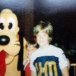My brother, Steve, and me meeting Pluto at Disney World